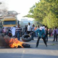Protesters set tires alight as work begins on a $50 billion China-backed interoceanic canal in Rivas, Nicaragua, on Dec. 22. | AFP-JIJI