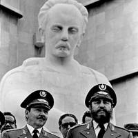 Cuban President Fidel Castro (right) and his brother, Raul, attend the 20th anniversary of the Triumph of the Revolution at Revolution Square in Havana on Feb. 1, 1979.   REUTERS