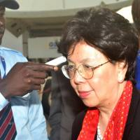 WHO chief Margaret Chan has her temperature checked as she arrives in the Guinean capital of Conakry on Dec. 20. | AFP-JIJI