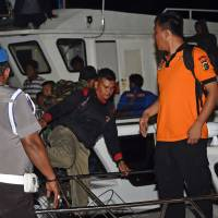 Search for missing AirAsia jet focuses on fuel patch off Indonesia