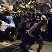Hong Kong warns protesters not to return after clashes close government HQ