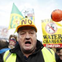 Thousands crowd Dublin to denounce Irish water tax