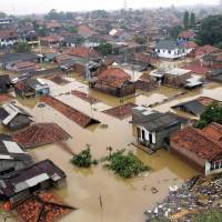 An aerial view of a flooded residential area in east Jakarta is seen in February 2007. At 3 inches a year, no city is sinking faster than the Indonesian capital. | REUTERS