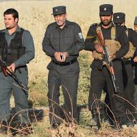 Kabul police chief Zahir Zahir (second from the left) resigned on Sunday, a police spokesman said. The Afghan capital has been hit by at least nine militant attacks in the last two weeks. | AFP-JIJI