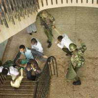 During demonstrations over the proposed increase in student fees last May, Kenyan riot police wielding clubs beat students and university staff members after they surrendered to escape from a tear gas-filled building inside Nairobi University's main campus. Ordinary Kenyan cops have doled out death to terrorism suspects, civilians and even children | AP