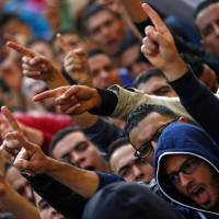 Protests, mockery erupt after charges against Egypt's Mubarak are dropped