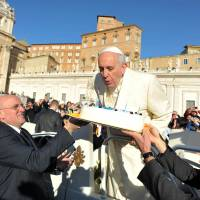 Pope gets cake, tango and chicken for 78th birthday