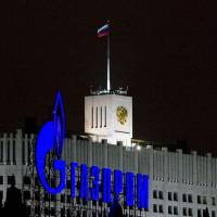 A Gazprom sign is seen in front of the White House, the official residence of then-Russian Prime Minister Vladimir Putin, in Moscow in January 2009.   REUTERS