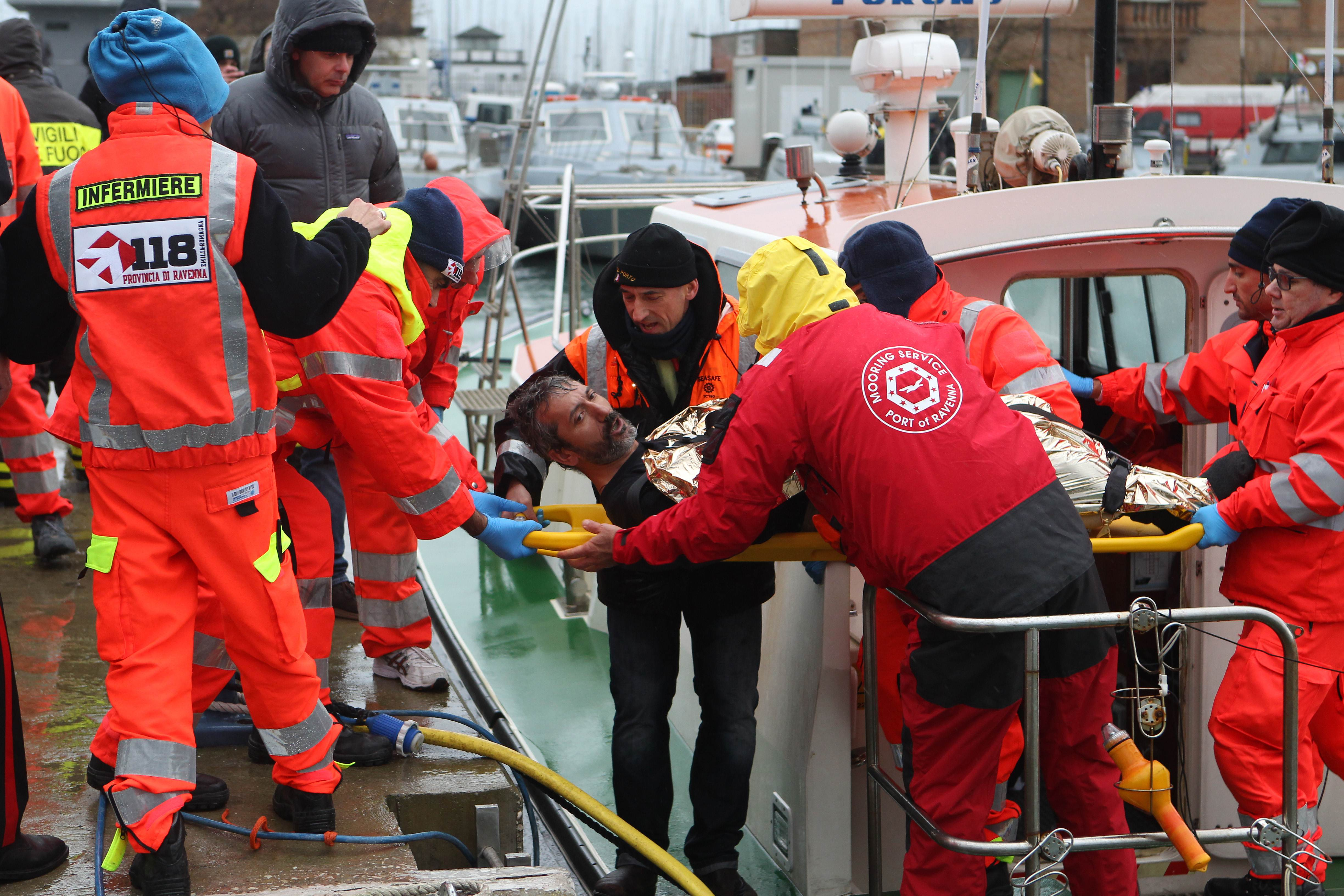 A rescued sailor is brought ashore in the harbor at Ravenna on Sunday. Three seamen were missing, feared drowned after a Turkish-registered merchant ship sank off Italy following a collision with a Belize-registered vessel in rough Adriatic seas, the coast guard said.   AFP-JIJI