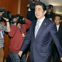 Prime Minister Shinzo Abe arrives Monday for an executive meeting at Liberal Democratic Party headquarters in Tokyo. | KYODO