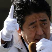 Prime Minister Shinzo Abe campaigns in Tokyo in the run-up to Sunday's general election.   REUTERS