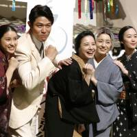 Yuriko Yoshitaka (center) and her co-stars in 'Hanako and Anne' pose for a commemorative photo in Yokohama on Aug. 26 after shooting for the series wrapped up. | KYODO