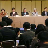 Members of a third-party panel studying the Asahi Shimbun's retraction of articles on the 'comfort women' issue hold a news conference in Tokyo on Monday. | KYODO