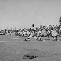 Japanese-American teams from the Gila River internment camp in Arizona and the Heart Mountain camp in Wyoming play ball in September 1944. | JAPANESE AMERICAN NATIONAL MUSEUM/KYODO