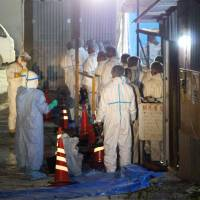 Yamaguchi prefectural personnel prepare Tuesday to cull chickens at a farm with an outbreak of highly pathogenic avian influenza in the city of Nagato. | KYODO