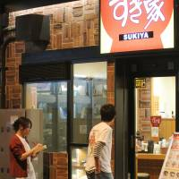 Members of a group fighting exploitative firms check on Oct. 11 whether a Sukiya outlet in Taito Ward, Tokyo, is using a one-person operation. | KYODO