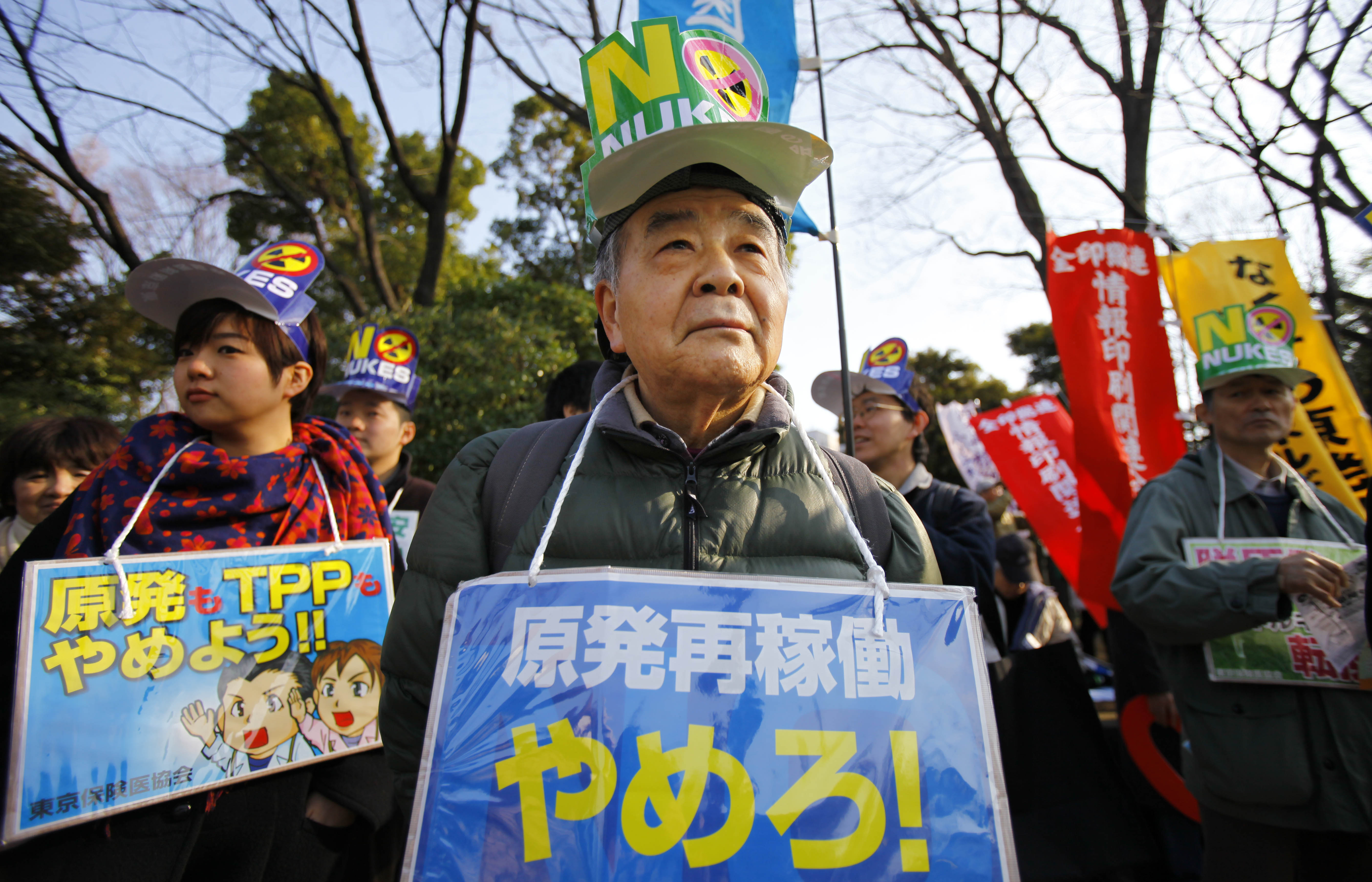 Protesters stage an anti-nuclear demonstration outside the Diet in Tokyo in March. Participants at the demonstration said they would never forget the March 11, 2011, nuclear disaster, the worst since Chernobyl. The placard, center, reads: 'No to restarting nuclear reactors!'   AP