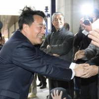Democratic Party of Japan leader Banri Kaieda greets voters as he kicks off campaigning for the Dec. 14 election in the city of Fukushima on Tuesday. | KYODO
