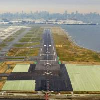 Haneda airport's 3-km Runway C, shown Nov. 8, will be extended to accommodate the biggest jetliners.   KYODO