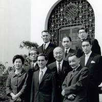 Donald Keene (front center) poses for a photo with Haru Reischauer (front left), wife of then U.S. Ambassador to Japan Edwin Reischauer (third row, left), renowned author Yukio Mishima (second row, right) and others in front of the U.S. Ambassador's Residence in Tokyo upon receiving the Kikuchi Kan Prize in 1962. | COURTESY OF DONALD KEENE