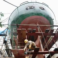 Ship repairs are underway at Sanwa Dock Co.'s plant on Innoshima Island, Hiroshima Prefecture, in October. The shipbuilding industry faces a serious labor shortage amid surging orders. | KYODO