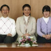 Crown Princess Masako is flanked by Crown Prince Naruhito and Princess Aiko for a photo in their residence, Togu Palace, in Tokyo on Nov. 30. | IMPERIAL HOUSEHOLD AGENCY OF JAPAN/REUTERS
