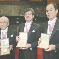 Physics trio collect Nobel prize at gala