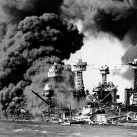 The USS West Virginia and the USS Tennessee burn on Dec. 7, 1941, after Japanese aircraft attacked Pearl Harbor. | REUTERS/KYODO