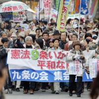 People calling for protection of war-renouncing Article 9 of the Constitution protest in Tokyo on Nov. 24 against the Cabinet's approval to allow Japan to exercise the right of collective self-defense.   KYODO