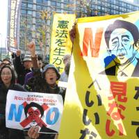 Opponents of the state secrecy bill rally near the Diet building in November 2013. Satoko Kawasaki