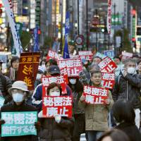 People opposing the state secrets law march in the streets of Tokyo's Ginza district during a demonstration Saturday. | KYODO