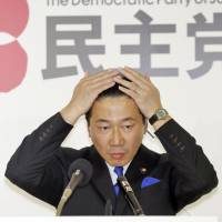 Democratic Party of Japan policy chief Tetsuro Fukuyama is interviewed by a TV reporter at the party's Tokyo headquarters just before polls closed in Sunday's general election. | KYODO