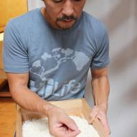 In his North Shore facility in Hawaii, Ken Hirata makes mold-infused rice on Nov. 3. He uses 'koji' (mold) spores from Japan and premium California short-grain rice from Koda Farms. | KYODO