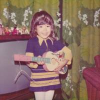 Pictured at home in Sweden with a ukelele, LiLiCo dreamed of becoming a performer from a young age. | COURTESY OF LILICO