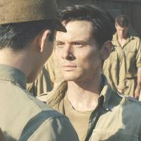 Jack O'Connell portrays Olympian and war hero Louis 'Louie' Zamperini in a scene from 'Unbroken.' | AP