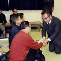 Yoshimi Watanabe, former head of the now-defunct Your Party, exchanges greetings with a supporter at a gathering in Nasushiobara, Tochigi Prefecture, on Dec. 9, ahead of last Sunday's Lower House snap election in which he lost his Diet seat. | KYODO