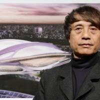 Hats off: Architect Tadao Ando introduces the design for the new national stadium by Zaha Hadid Thursday in Tokyo. | AFP-JIJI