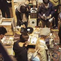 Digging in the crates: People shop for music at the Red Bull Music Academy's Culture Fair in Tokyo last month. | YASUHARU SASAKI/RED BULL CONTENT POOL