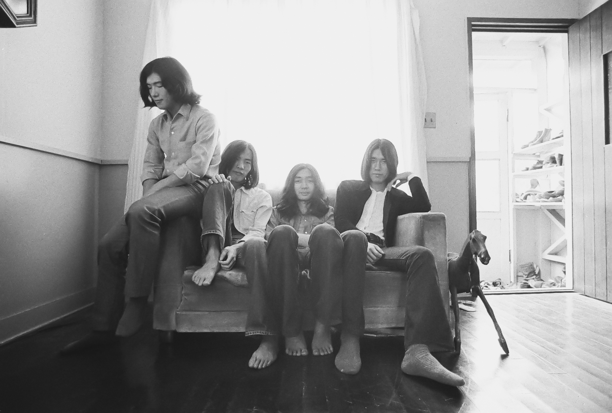 Early days: Japanese rock group Happy End takes a break during an album photo shoot in 1971.   © MIKE NOGAMI