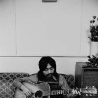 Early days: Haruomi Hosono, who played bass in the rock group Happy End before joining Yellow Magic Orchestra, relaxes at his home in Sayama's Amerikamura in 1972. | © MIKE NOGAMI