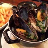 Shelling out: Antwerp Central serves Belgium's national dish, moules frites, in a bourguignon style with butter, white wine, parsley and garlic. | ALEX DUTSON