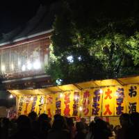 Temple treats: The food stalls get lively on New Year's Eve at Osu Kannon Temple in Nagoya. | ADAM MILLER