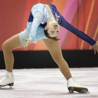 Iconic moment: Shizuka Arakawa performs an 'Ina Bauer' during her free skate at the Turin Olympics on Feb. 23, 2006, where she became the first Japanese to win the gold medal. | AP