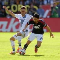 Galaxy beat Revs for MLS Cup title