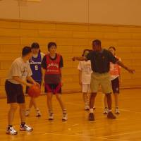 Passing along tips: Dwane Casey began coaching in Japan in 1989, providing instruction to players of all ages and skill levels, including, as seen in this photo, the Hakuoh University women's basketball team. | TOSHI SATO