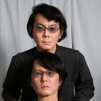 Who's who?: Hiroshi Ishiguro, a professor at Osaka University's Department of System Innovation, poses with Geminoid H1-4 — the robot in front of him.  | COURTESY OF OSAKA UNIVERSITY (GEMINOID IS A REGISTERED TRADEMARK OF ADVANCED TELECOMMUNICATIONS RESEARCH INSTITUTE INTERNATIONAL)
