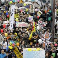 Boiling point: Protesters carry a model of a nuclear plant building in Tokyo in May 2011. | AP