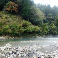 Natural delight: Locals in Kawayu, Wakayama Prefecture, create a massive open-air bath on the banks of the Ohtou River every winter. | MANDY BARTOK