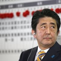 Thin-skinned: Prime Minister Shinzo Abe isn't taking kindly to criticism over his 'Abenomics' economic policy and is instead hitting back at the media for being unfair. | REUTERS