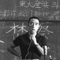 War of words: Yukio Mishima speaks during a debate at the University of Tokyo in May 1969. | KYODO